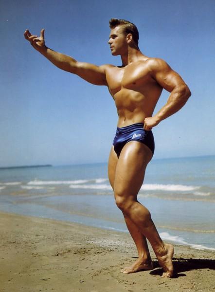 50s model stud DouglaS posing on beach (color)